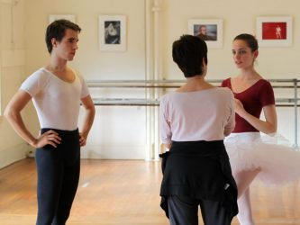 Paula K. Shiff instructs a male and female ballet dancers